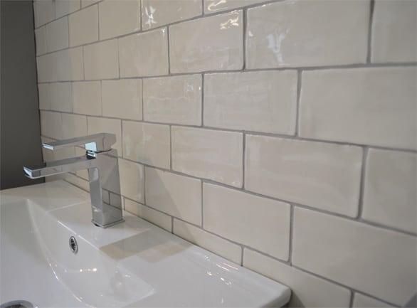 White brick tiles used behind a bathroom sink