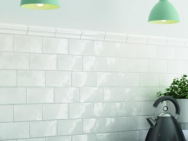 White gloss tiles which are set as a kitchen splashback
