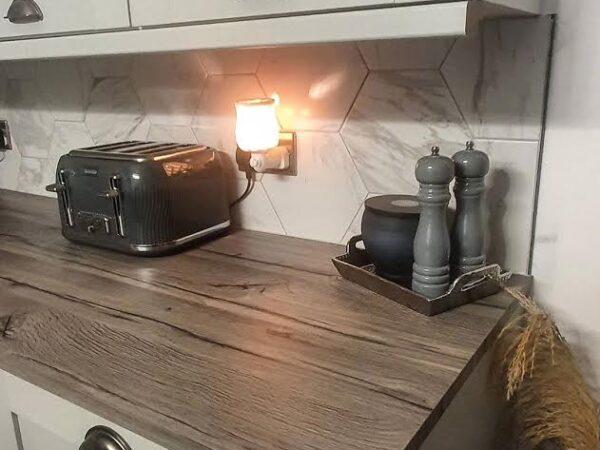 Marble effect tiles set as a kitchen splashback